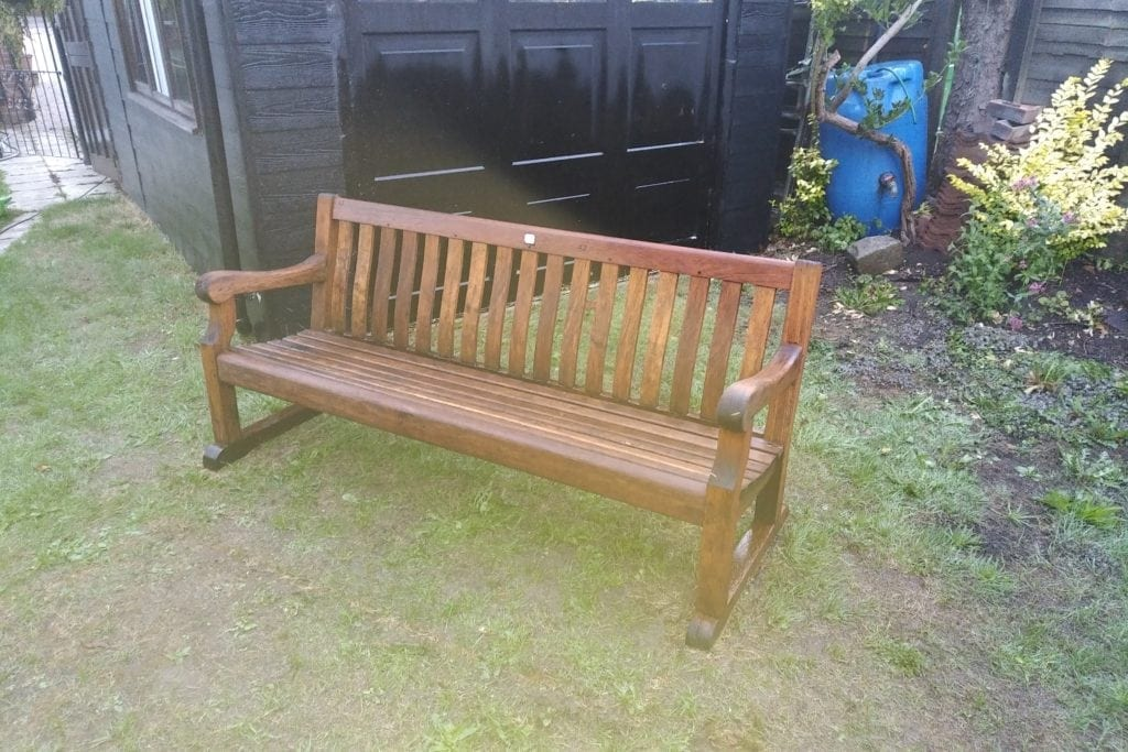 teak bench cleaned with doff / thermatech super-heated steam cleaner